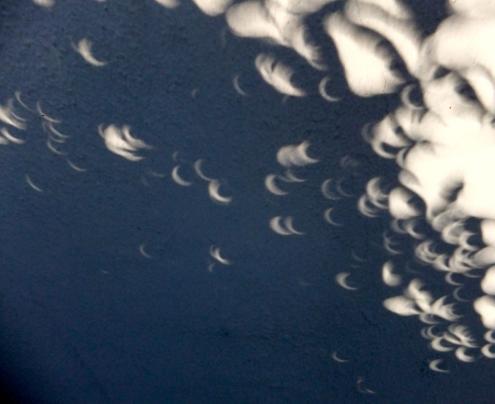 Eerie Shadows from 2012 Solar Eclipse. Do you see a face?