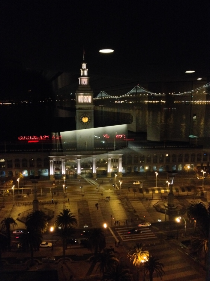 Space ships landing on Ferry Building or reflection form window of Hyatt Embarcadero