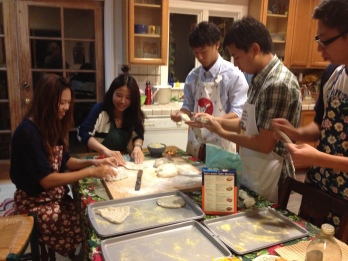 Cindy Lee and friends making pizza