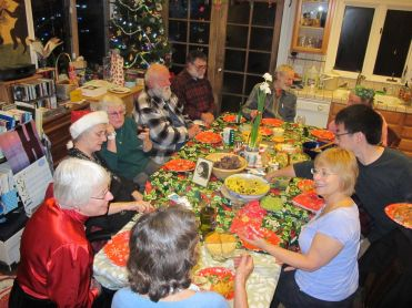 Everyone around the Table for Christmas. I'm in the red hat!