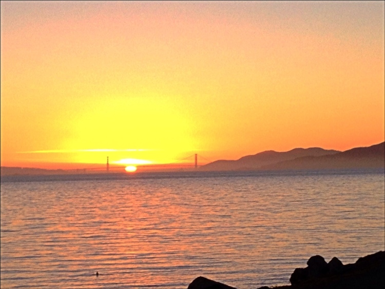 Sunset between the towers of the Golden Gate Bridge. Only Happens on Winter Solstice