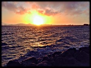 Sun setting far north of Mount Tam