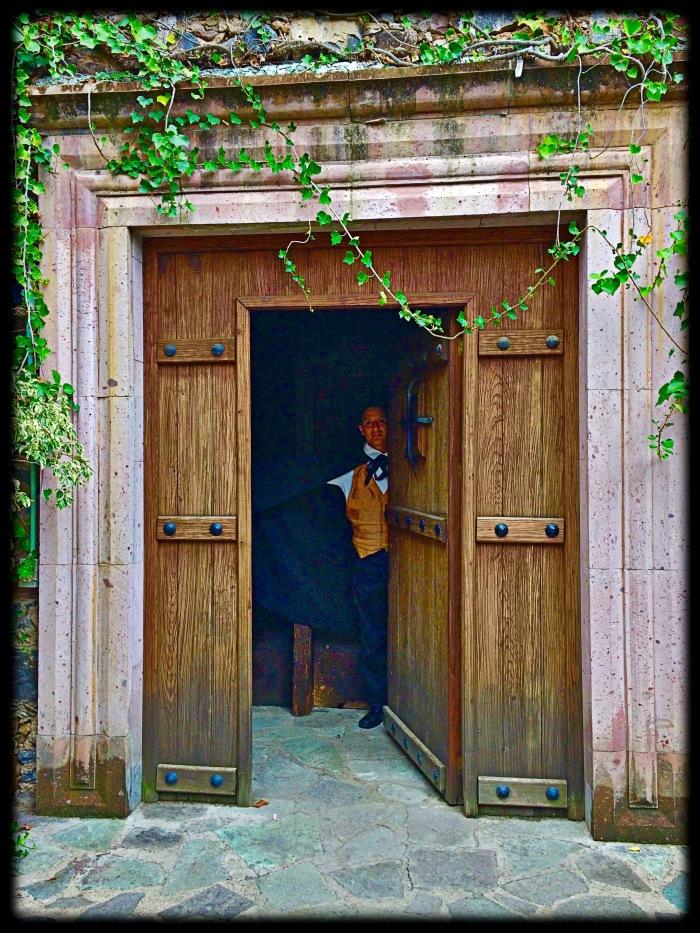 Open door to Caped man