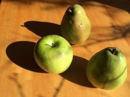 Three green fruit