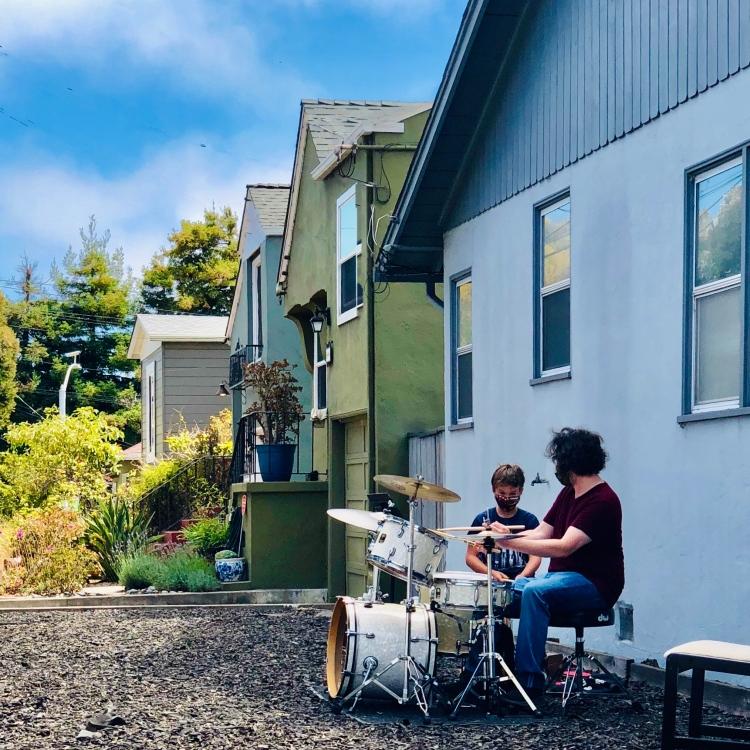 Boys playing drum set